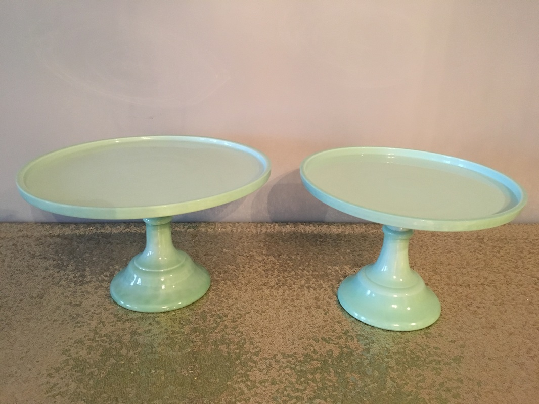 large and small ceramic cake stands mint green